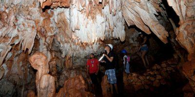 Visitors inside the caves of el choco cabarete