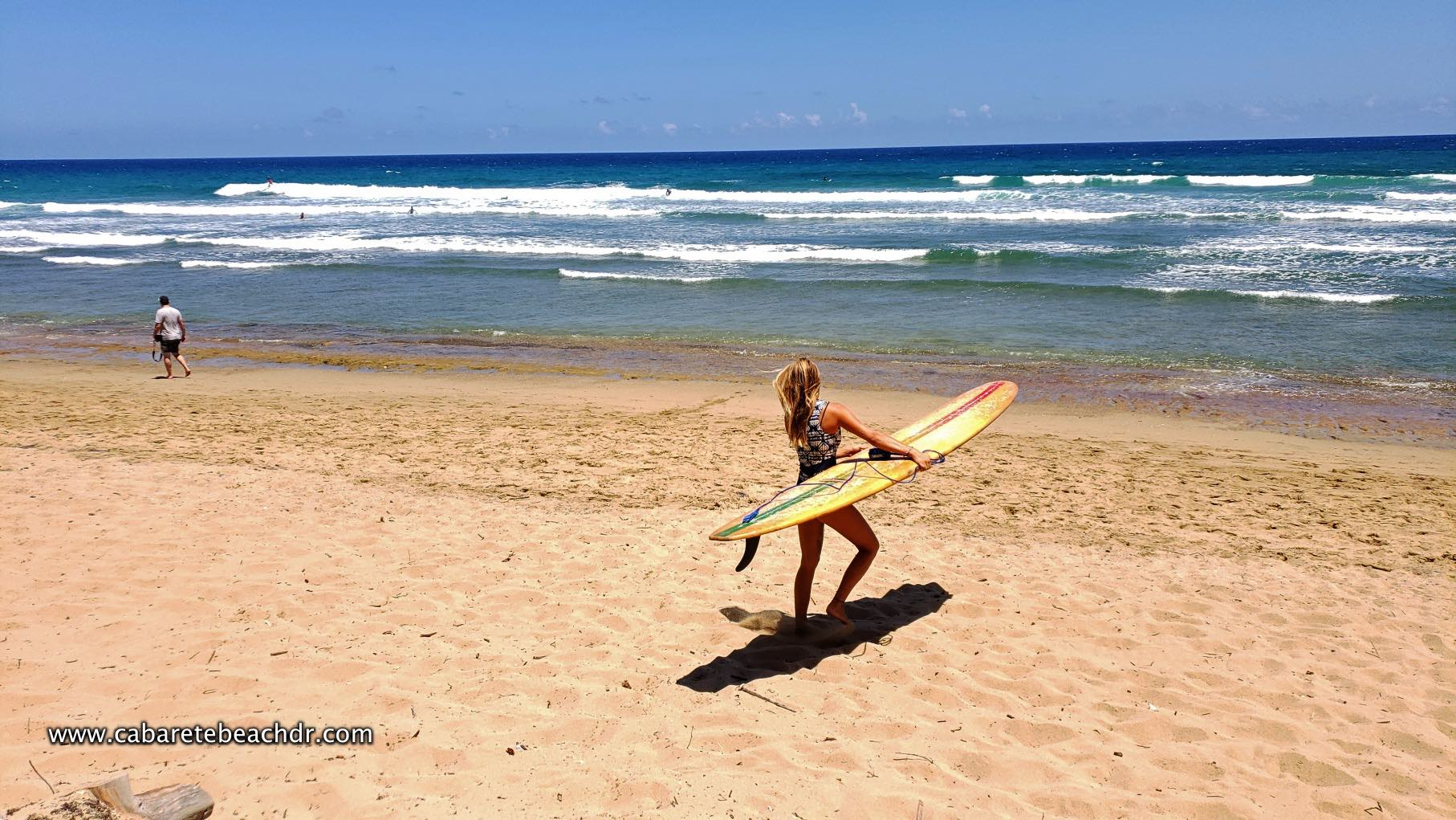 Blonde woman with surfboards