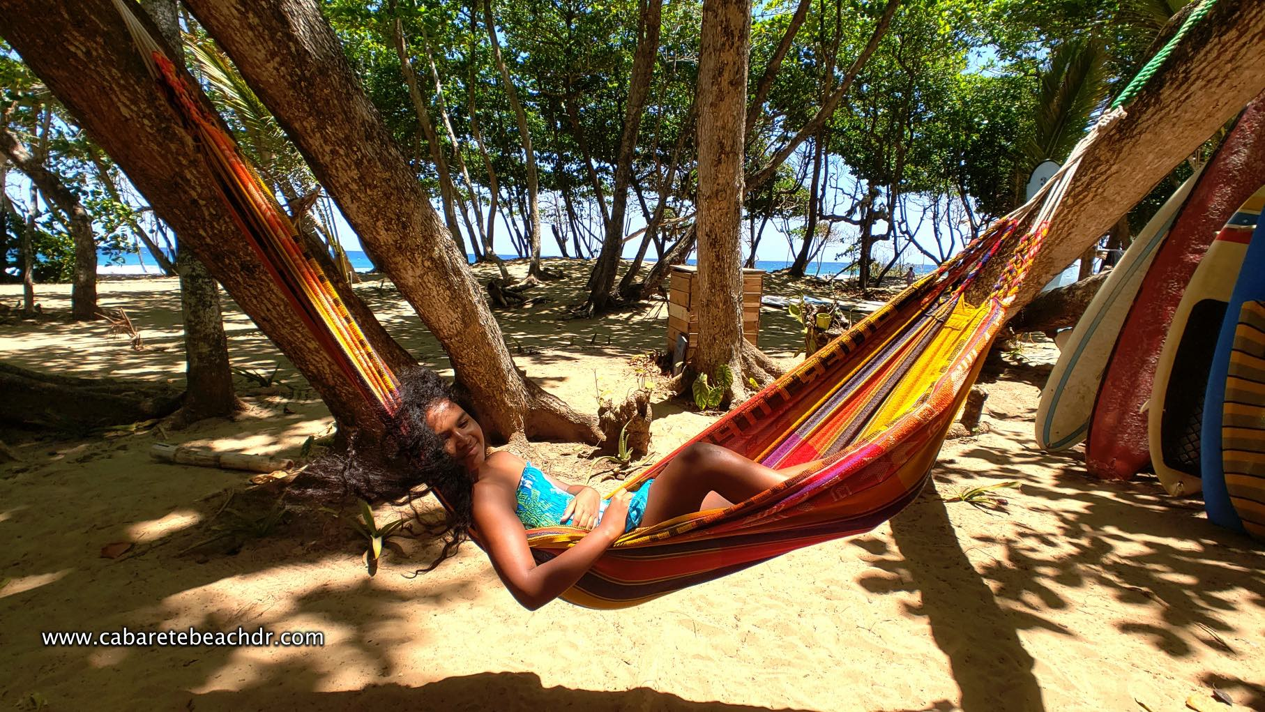 Young girl relaxing in hammock