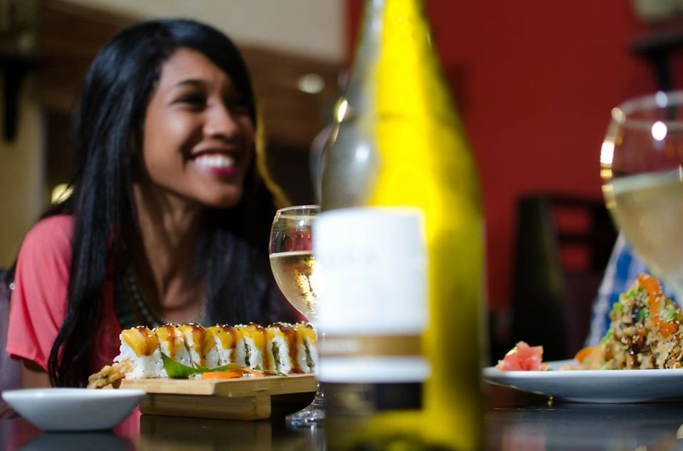 Girl smiles at table