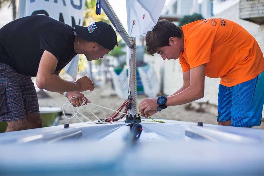 boys rig a laser boat